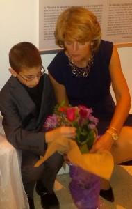 Nicholas helps Senator Lisa Murkowski arrange flowers she received as Gala Honorary Host.