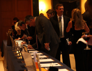 Guest bid on silent auction items at the 2014 NOFAS International Gala at the Embassy of Italy